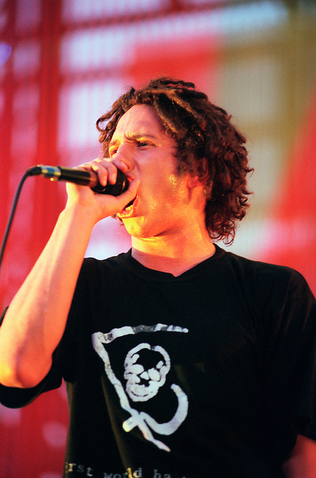 Zack de la Rocha of the band Rage Against the Machine sings during a performance in Los Angeles, California in 1997. Rage Against the Machine, is an American rock band, formed in Los Angeles, California in 1991. The band's continual members are vocalist Zack de la Rocha, guitarist Tom Morello, bassist Tim Commerford, and drummer Brad Wilk. Rage Against the Machine is noted for its blend of hip hop, heavy metal, punk and funk as well as its revolutionary politics and lyrics. The group's music is distinguished primarily by de la Rocha's rhyming styles and powerful stage energy, and Morello's unorthodox guitar techniques..
