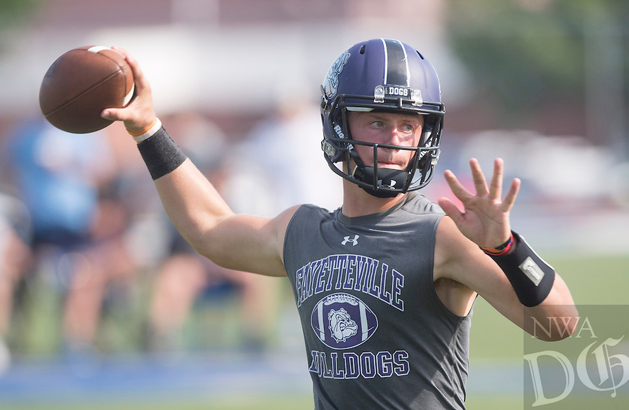 NWA Democrat-Gazette/J.T. WAMPLER -Fayetteville High School quarterback Taylor Powell looks for a receiver during the championship game of Southwest Elite 7 on 7 Tournament against Springdale Har-Ber High School at Shiloh Christian Saturday July 11, 2015.