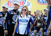Apr. 3, 2011; Las Vegas, NV, USA: NHRA funny car driver Robert Hight (left)celebrates with daughter Autumn Hight (right) and Brittany Force (center) after winning the Summitracing.com Nationals at The Strip in Las Vegas. Mandatory Credit: Mark J. Rebilas-