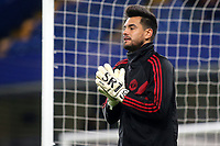 Manchester United goalkeeper, Sergio Romero, warms up ahead of kick-off during Chelsea vs Manchester United, Emirates FA Cup Football at Stamford Bridge on 18th February 2019