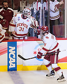 Nick Meldrum (DU - Equipment Manager), Evan Cowley (DU - 31), Jarid Lukosevicius (DU - 14) - The University of Denver Pioneers defeated the University of Minnesota Duluth Bulldogs 3-2 to win the national championship on Saturday, April 8, 2017, at the United Center in Chicago, Illinois.