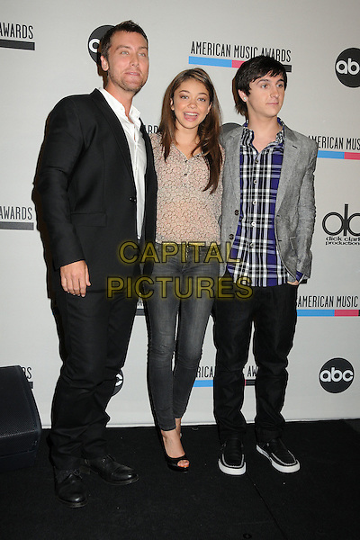 Lance Bass, Sarah Hyland & Mitchel Musso .2011 American Music Awards Nominee Press Conference held at the JW Marriott LA Live Hotel, Los Angeles, California, USA..October 11th, 2011.full length black suit white shirt jeans denim beige top check shirt sheer.CAP/ADM/BP.©Byron Purvis/AdMedia/Capital Pictures.