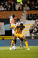 Jackson Irvine of Hull City holds off Floyd Ayité of Fulham   during the Sky Bet Championship match between Fulham and Hull City at Craven Cottage, London, England on 13 September 2017. Photo by Carlton Myrie.