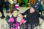 Narden Sullivan from Tralee getting her face painted by the Wicked Witch Samantha Houlihan at the Manor West Retail Park's Halloween Family Fun Day on Saturday.