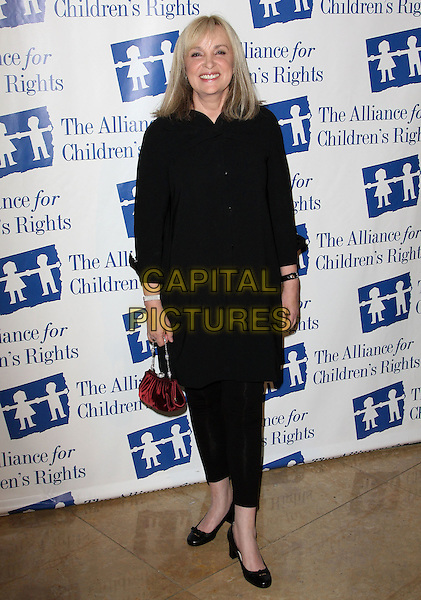 BRENDA HAMPTON.Attending The Alliance for Children's Rights held At The Beverly Hilton Hotel, Beverly Hills, California, USA,.10th February 2010..full length black shirt dress bag red shoes .CAP/ADM/KB. ©Kevan Brooks/AdMedia/Capital Pictures..