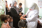 MAFRAQ District Jordan, March 4th, 2014 :  Polio immunization in an Health Center in the Governorate of Mafraq, Jordan, during the polio mass immunization campaign taking place in five high-risk countries bordering Syria. Mafraq Governorate covers one fifth of Jordan and border Syria, Iraq and Saudi Arabia. It has a population of 306,000 jordanians plus 400,000 syrian refugees. A total of 56,000 children under five are being immunized during the campaign  (Photo by Jean-Marc Giboux)