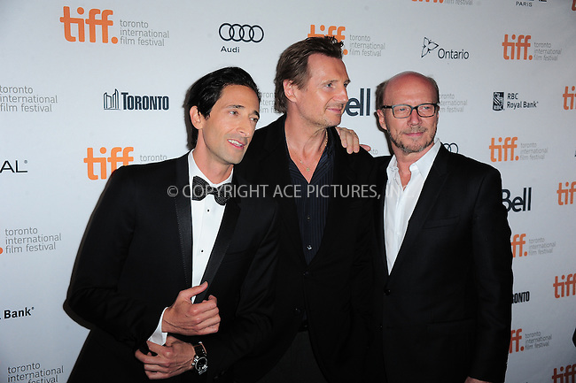 WWW.ACEPIXS.COM<br /> <br /> September 9 2013, Toronto<br /> <br />  (L-R) Actors Adrien Brody, Liam Neeson and filmmaker Paul Haggis arriving at the 'Third Person' Premiere during the 2013 Toronto International Film Festival at The Elgin on September 9, 2013 in Toronto, Canada.<br /> <br /> By Line: William Bernard/ACE Pictures<br /> <br /> <br /> ACE Pictures, Inc.<br /> tel: 646 769 0430<br /> Email: info@acepixs.com<br /> www.acepixs.com