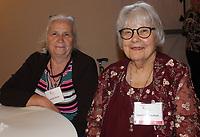 NWA Democrat-Gazette/CARIN SCHOPPMEYER Bonnie Kizzar (left) and Janet Steenken, 14-year CASA volunteer, enjoy the Celebration of Success.