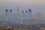 Los Angeles skyline sunset view from Mulholland Drive  with heavy smog in the air over Los Angeles California USA.