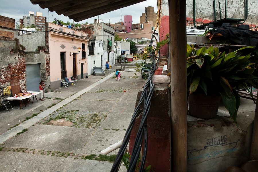 View of Calle Curuguaty in a traditional black neighborhood (Barrio Sur) of Montevideo.  One of the most imporant elements of Carnaval in Uruguay is Candombe, an African drum rhythm played on tambor drums.  It was revitalized in the Americas by black slave descendents as a way by which to reclaim their cultural heritage and battle for civil rights.