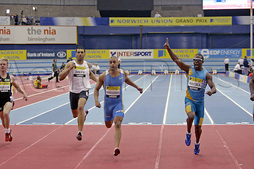 18 February 2006: Cuban athlete Freddy Mayola crosses the finish line to win the Men's 60m race at the indoor Norwich Union Grand Prix, held at the N.I.A in Birmingham. Photo: Glyn Kirk/Actionplus....060218 athletics male  man  men finish line