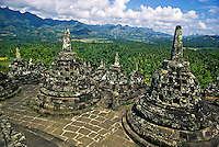 Borobudur Buddhist Temple near Jogjakarta.  The world's largest Buddhist temple, over 1100 years old, a man-made mountain.  The world's largest stupa and the world's largest ancient monument in the southern hemisphere. Java, Indonesia.