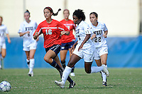 2 October 2011:  FIU's Paige Covington (3) and Carlan Jones (22) and South Alabama's Emi Passini (16) chase after a loose ball in the first half as the FIU Golden Panthers defeated the University of South Alabama Jaguars, 2-0, at University Park Stadium in Miami, Florida.