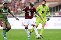 27th October 2019; Olympic Grande Torino Stadium, Turin, Piedmont, Italy; Serie A Football, Torino versus Cagliari; Daniele Baselli of Torino FC clears the ball watched by his goalkeeper - Editorial Use