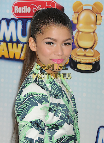 Zendaya Coleman.At the Radio Disney Music Awards 2013 held at Nokia Theatre LA Live, Los Angeles, California, USA,.27th April 2013..headshot portrait green white leaf print pink lipstick make-up hair up side.CAP/ROT/TM.©Tony Michaels/Roth Stock/Capital Pictures