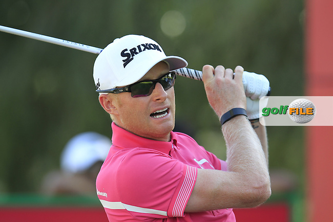Simon DYSON (ENG) tees off the 18th tee during Pink Friday's Round 2 of the 2015 Omega Dubai Desert Classic held at the Emirates Golf Club, Dubai, UAE.: Picture Eoin Clarke, www.golffile.ie: 1/30/2015