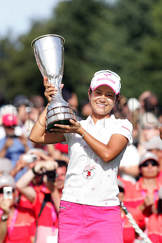 Ai Miyazato (JPN), JULY 26, 2009 - Golf : Ai Miyazato of Japan celebrates with the trophy after winning in a playoff during the final round of the Evian Masters at the Evian Masters Golf Club in Evian-les-Bains, France. (Photo by Yasuhiro JJ Tanabe/ActionPlus) UK Licenses Only