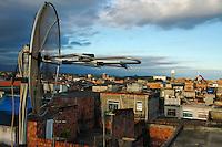 TV antenna on a house´s cover-slab in Favela da Maré, Rio de Janeiro, Brazil.