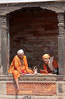 Pashupatinath, Nepal.  Sadhus, Hindu Ascetics, Rest Inside a Pati, an Open-air Resting Place.
