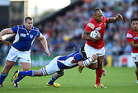Vunga Lilo of Tonga is tackled in possession. Rugby World Cup Pool C match between Tonga and Namibia on September 29, 2015 at Sandy Park in Exeter, England. Photo by: Patrick Khachfe / Onside Images