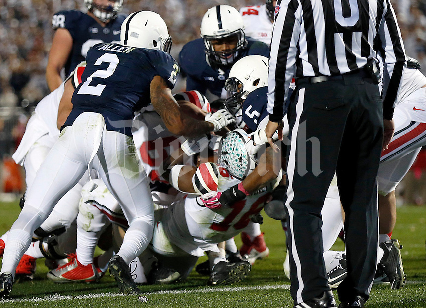 Ohio State Buckeyes quarterback J.T. Barrett (16) scores the winning touchdown in the second overtime of the NCAA Division I football game at Beaver Stadium in University Park, PA on October 25, 2014. (Columbus Dispatch photo by Jonathan Quilter)