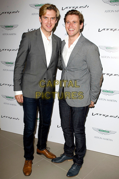 Dan Stevens and Tom Branson.Aston Martin Vanquish Launch Party at the London Film Museum, Covent Garden, London, England..July 4th 2012.full length black white grey gray suit jacket shirt jeans denim .CAP/PP/CB.©Cliff Bass/PP/Capital Pictures.