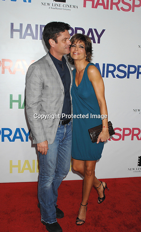 "Harry Hamlin and wife Lisa Rinna..arriving at the New York Premiere of ""Hairspray"" on         July 16, 2007 at The Ziegfeld Theatre. ..Robin Platzer, Twin Images......212-935-0770"