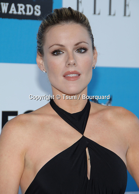 Kathleen Robertson arriving at the Film Independent's 22th SPIRIT AWARDS in Santa Monica Beach in Los Angeles.<br /> <br /> headshot<br /> smile<br /> eye contact<br /> black dress