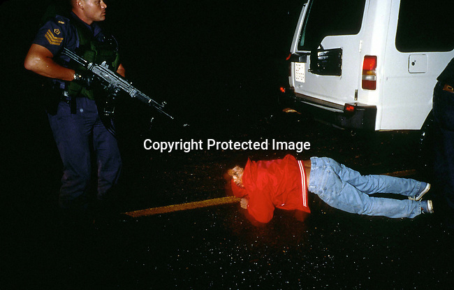 PSPOLIC27216.Police. Police officers belonging to Flying Squad, a special rapid response unit in Johannesburg, South Africa arresting a suspected car thief on February 16, 1999 in Hillbrow, a crime infested area in Johannesburg, South Africa.  This unit has a reputation for being hard on suspects.   .©Per-Anders Pettersson/ iAfrika Photos
