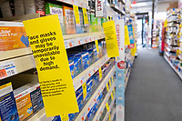 """A sign reads """"Face masks are temporarily unavailable due to high demand global supply shortage"""" in the first-aid section of a CVS pharmacy in Belmont, Massachusetts, on Fri., March 20, 2020. Masks and gloves have been sold out around the globe as people bought supplies in response to the growing coronavirus COVID-19 global pandemic. Now, most of those supplies are being redirected to hospitals and healthcare workers as they become available."""