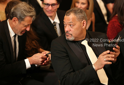 Actor Jeff Goldblum  (L) and actor Laurence Fishburne (R) wait for the beginning of an event for the 2016 Kennedy Center Honorees, in the East Room of the White House, December 4, 2016. The 2016 honorees are: Argentine pianist Martha Argerich; rock band the Eagles; screen and stage actor Al Pacino; gospel and blues singer Mavis Staples; and musician James Taylor.<br /> Credit: Aude Guerrucci / Pool via CNP