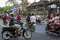 Jimbaran, Bali, Indonesia.  Motorbikes Dominate Balinese Street Traffic.
