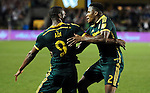 Jun 6, 2015; Portland, OR, USA; Portland Timbers forward Fanendo Adi (9) celebrates with Portland Timbers defender Alvas Powell (2) after he scored a goal during the second half of the game against the New England Revolution at Providence Park. The Timbers won the game 2-0. Mandatory Credit: Steve Dykes-USA TODAY Sports