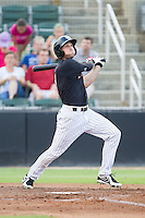 Hunter Jones (1) of the Kannapolis Intimidators follows through on his swing against the Charleston RiverDogs at CMC-NorthEast Stadium on June 27, 2014 in Kannapolis, North Carolina.  The Intimidators defeated the RiverDogs 6-5.  (Brian Westerholt/Four Seam Images)