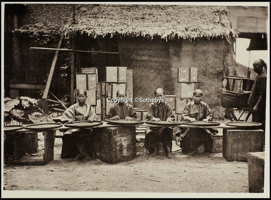 BNPS.co.uk (01202 558833)<br /> Pic: Sothebys/BNPS<br /> <br /> Sorting tea in Canton.<br /> <br /> Rare early photographs revealing what life in China looked like for the first time to the 19th century public have emerged 140 years after they were taken. <br /> <br /> The stunning collection - comprising 200 black and white photographs of Far East landscapes and wide-ranging personal portraits of everybody from rural peasants to senior government officials - was the first volume of photos from the region to ever be included in a travel book. <br /> <br /> Produced at a time when camera technology was still in its infancy, they were taken by celebrated Scottish photographer John Thomson between 1873 and 1874 during a 4,000-mile expedition across the country. <br /> <br /> And now one of the last remaining copies of the album still known to exist is set to go under the hammer at Sotheby's in London on November 7 with an estimate of £35,000.