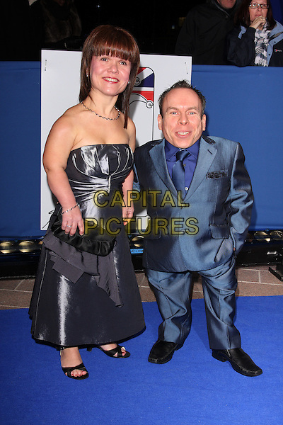 SAMANTHA & WARWICK DAVIS .Attending the British Comedy Awards 2011at Indigo, The O2 Arena, London.England, UK, January 22nd, 2011..arrivals full length blue suit strapless dress wife husband couple clutch bag married tie .CAP/ROS.©Steve Ross/Capital Pictures.