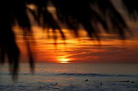 December 2, 2017 - San Diego, California, USA-  The sun sets at Windansea Beach as seen through a palm-covered shack in the La Jolla area of San Diego, California on Saturday, Dec. 3, 2017.   (Photo Credit: © K.C. ALFRED/ZUMA PRESS)