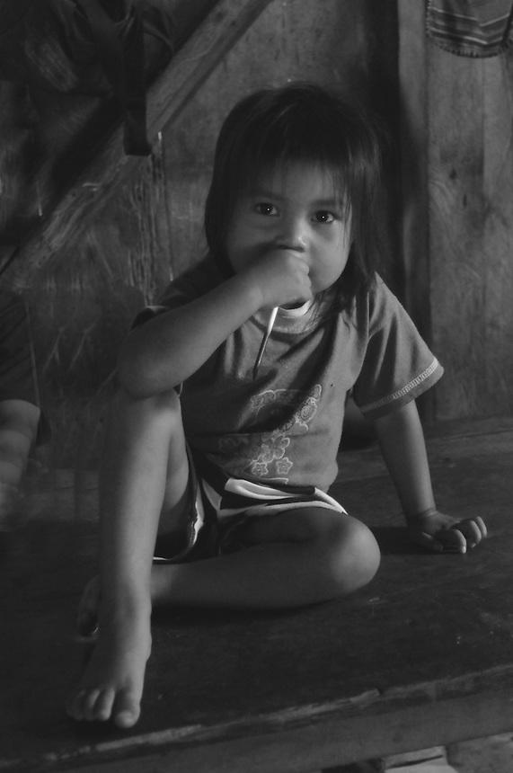 Quichua child in jungle village on the Rio Napo in Eastern Ecuador.
