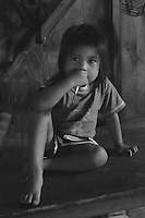 Quichua child in jungle village on the Rio Napo in Eastern Ecuador.
