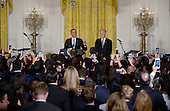 United States President Barack Obama (L) and Vice President Joe Biden attend a reception for Hispanic Heritage Month in the East Room of the White House on October 12, 2016 in Washington, DC. <br /> Credit: Olivier Douliery / Pool via CNP