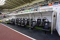 Pictured: Low Cost Vans sponsored seats in the dugout. Saturday 23 August 2014<br />