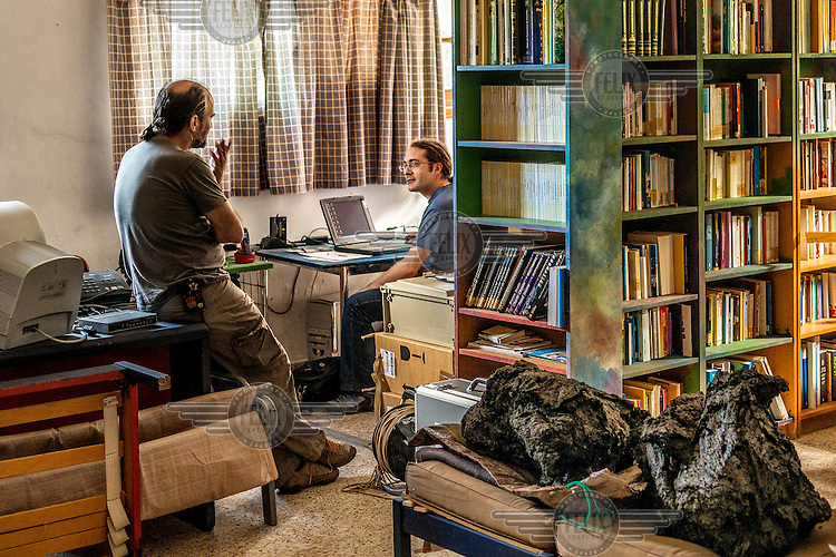 Rafael Abella and Vctor Villasante, two scientists from the Spanish Institute of Vulcanology at their office on the island of Hierro. /Felix Features
