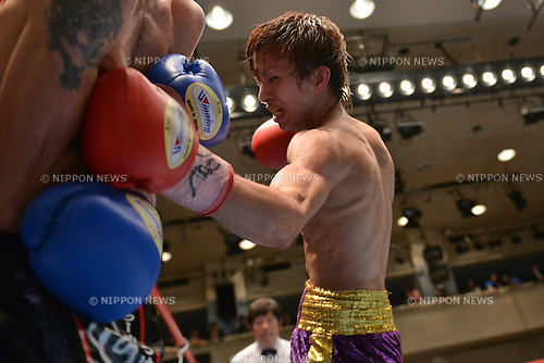 Ryoichi Taguchi,<br /> APRIL 3, 2013 - Boxing :<br /> Ryoichi Taguchi hits Yuki Chinen in the tenth round during the vacant Japanese light flyweight title bout at Korakuen Hall in Tokyo, Japan. (Photo by Hiroaki Yamaguchi/AFLO)