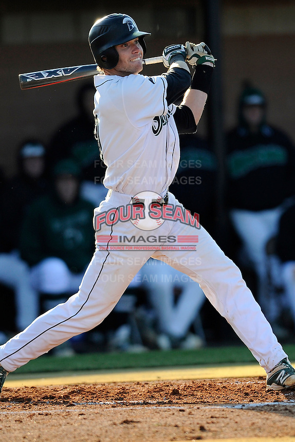 Catcher Luke Weber (9) of the University of South Carolina Upstate Spartans bats in a game against the UNC Asheville Bulldogs on Tuesday, March, 25, 2014, at Cleveland S. Harley Park in Spartanburg, South Carolina. (Tom Priddy/Four Seam Images)