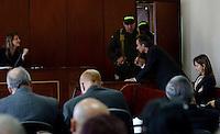 MEDELLÍN - COLOMBIA, 13-05-2014. El gerente de Lérida CDO, Pablo Villegas Mesa(MICROFONO) Y la directora de obra de esta unidad residencial, María Cecilia Posada Grisales(EXTREMO DERECHO), no aceptaron el cargo de homicidio culposo en la audiencia de imputación de cargos que se realiza este martes en el caso de la Torre 5 del edificio Space de la ciudad de Medellín que se desplomó en el mes de octubre de 2013 y que terminó con la demolición de la torre 5./ Lleida CDO manager, Pablo Villegas Mesa (MIC) and the director of the project of this residential unit, María Cecilia Posada Grisales (FAR RIGHT), did not accept the charge of manslaughter at the hearing of complaint charges Tuesday is done in the case of the Space Tower 5 building of the city of Medellin which collapsed in October 2013 and ended with the demolition of the tower 5..  Photo: VizzorImage/Luis Rios/STR