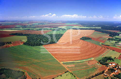 Parana State, Brazil. Aerial view showing farms (mixed crops) and forest areas.
