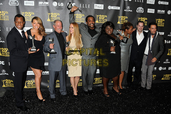 "Geoffrey Fletcher, Mariah Carey, Gary Magness, Sarah Siegel-Magness, Lee Daniels, Gabourey ""Gabby"" Sidibe, Lisa Cortes, Tom Heller and Asger Hussain.25th Annual Film Independent Spirit Awards - Press Room held at the Nokia Event Deck at L.A. Live, Los Angeles, California, USA, 5th March 2010..indie full length grey gray suit award trophy trophies black tie cream Precious winners winner dress .CAP/ADM/BP.©Byron Purvis/AdMedia/Capital Pictures."