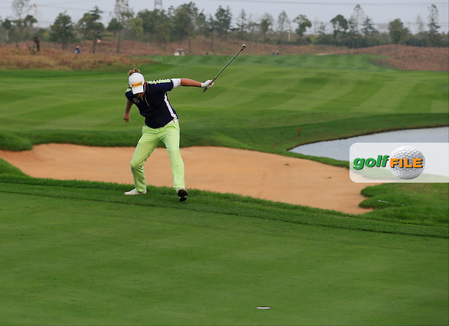 Marcel Siem (GER) chips in from the edge of the 18th green to win the playoff hole during Sunday's Final Round of the 2014 BMW Masters held at Lake Malaren, Shanghai, China. 2nd November 2014.<br /> Picture: Eoin Clarke www.golffile.ie