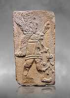 Aslantepe Hittite relief sculpted orthostat stone panel. Limestone, Aslantepe Malatya, 1200-700 B.C. Anatolian Civilizations Museum, Ankara, Turkey.<br /> <br /> Winged protective god holds a branch with fruits. in his left hand, and a fruit in his right hand.<br /> <br /> Against a grey art background.