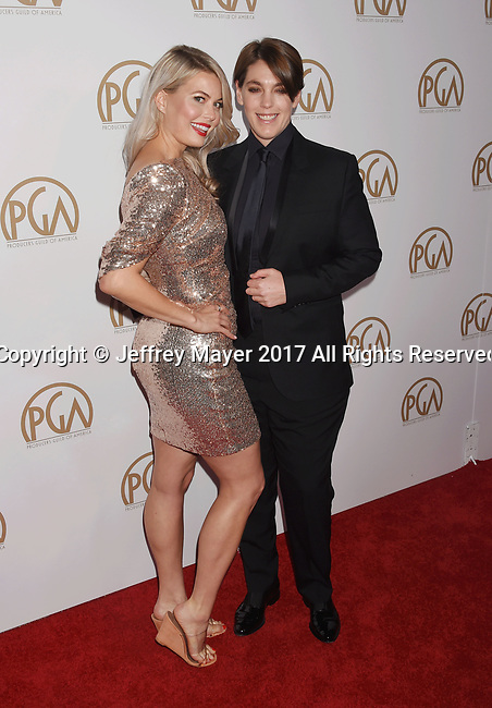 HOLLYWOOD, CA - JANUARY 28: Director Drew Denny (L) and producer Megan Ellison arrive at the 28th Annual Producers Guild Awards at The Beverly Hilton Hotel on January 28, 2017 in Beverly Hills, California.